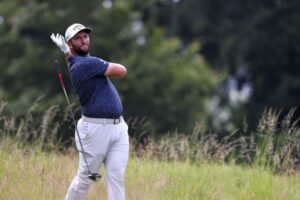 Golf: Rahm leads, McIlroy misses cut after spectator swipes club at Scottish Open, Golf News & Top Stories