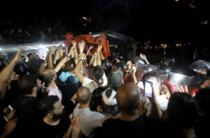 Families of Lebanese blast victims protest interior minister