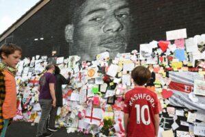 Demonstrators gather at vandalised Marcus Rashford mural over England football racism, Europe News & Top Stories