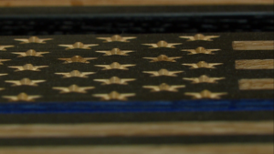 Centennial man honors officers with wooden blue line flags